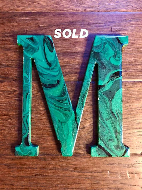 "SOLD.  ""M"""