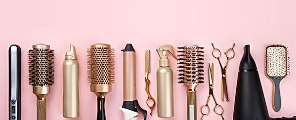 Professional hair dresser tools on pink