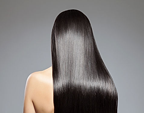 Back view of a woman with long straight