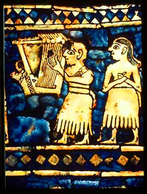 """Detail of the """"Peace"""" panel of the Standard of Ur showing lyrist, excavated from the same site as the Lyres of Ur. (Credit: Wikipedia)"""