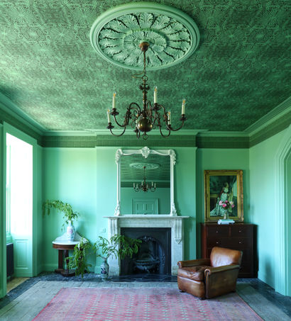 bespoke green paint at man with a hammer