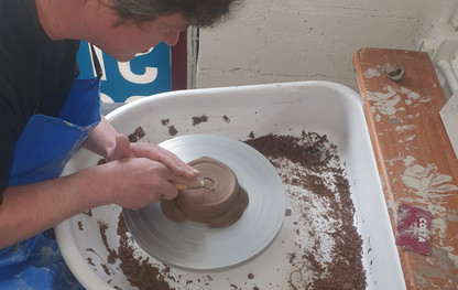working in clay wheel.jpg