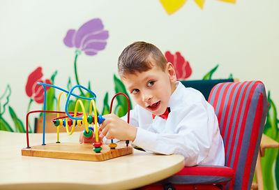 Kid solving logical puzzle in rehabilita