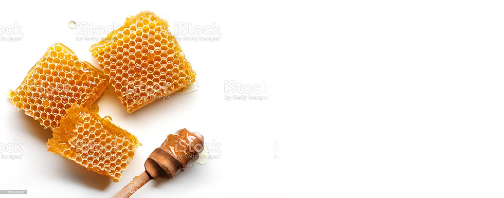 honeycomb-with-honey-spoon-isolated-on-w