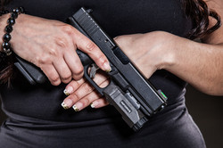 girl holding glock with inforce apl