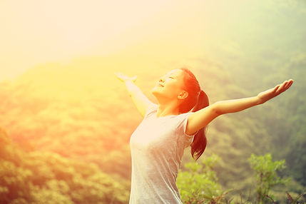 woman with arms wide open because she feels free from worry