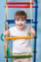 boy on therapy ladder swing