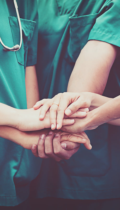 Doctors and nurses coordinate hands.jpg