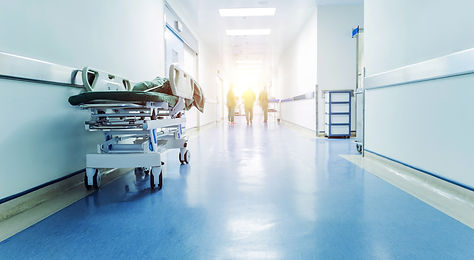 Doctors and nurses walking in hospital hallway, blurred motion.jpg
