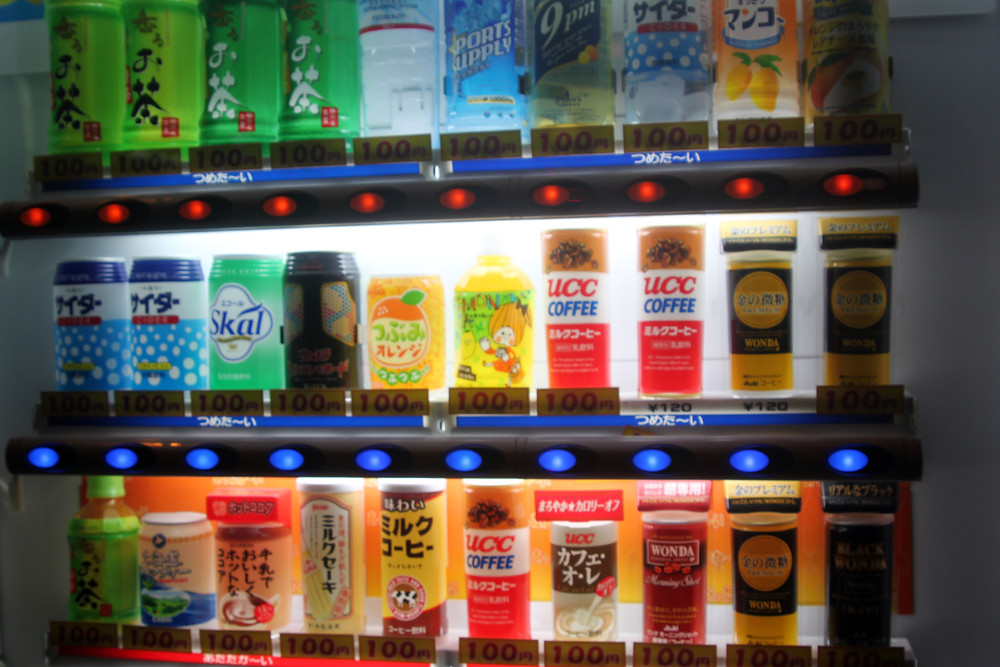 a vending machine in Japan featuring colourful drinks