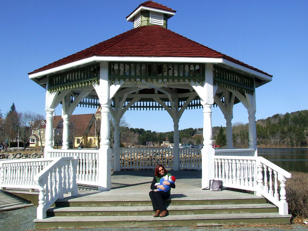 mother and child sitting on the steps of a Gazebo