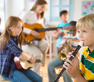 Elementary School Music Class with Teacher