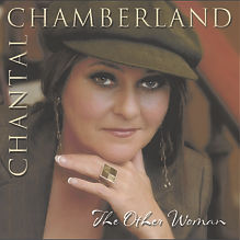 "Chantal ChamberlandThe Other Woman    Over the course of her previous three albums, Chamberland has perfected her presence as a modern day throwback to the classic jazz singer. Her rich, velvety voice is well suited for capturing the emotion and nuance in classic torch songs, which she performs with seemingly effortless grace. THE OTHER WOMAN continues in the same vein as her previous work, with Chamberland sensually covering favorites like ""What a Difference A Day Makes,"" ""All I Ask of You"" from ""Phantom of the Opera,"" ""On the Street Where You Live"" and ""La Mer."" The arrangements range in tone from upbeat to intimate, with jazz ensemble backing on brass, strings and light percussion."