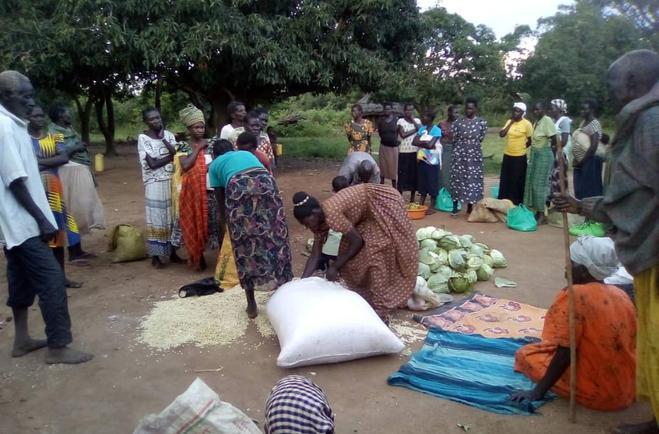 John with women receiving maize.jpeg
