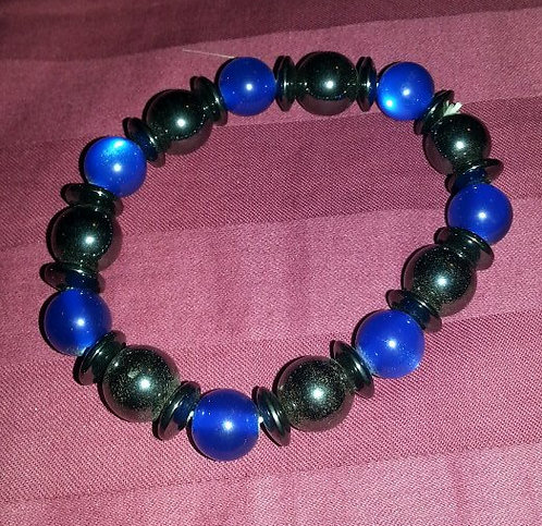 Blue and black magnetic bracelet. Stretchy. Heavy