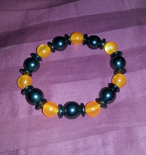 Orange and black magnetic bracelet. Stretchy. Heav