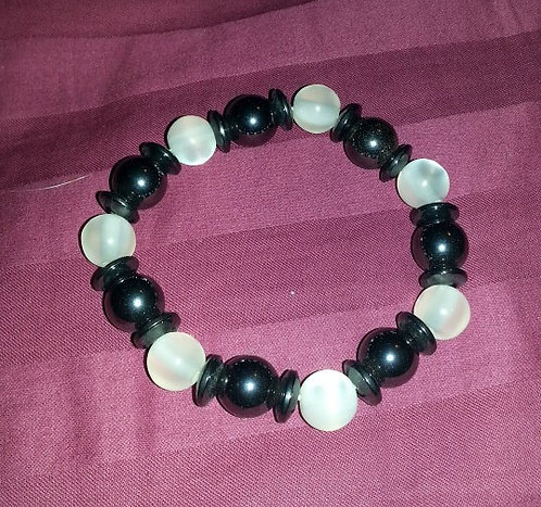 White/clear and black magnetic bracelet. Stretchy.