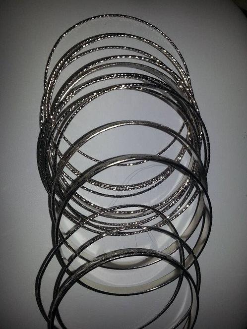 A dozen silver bangles