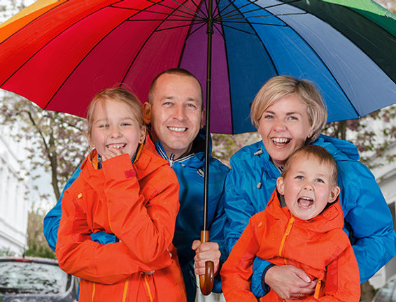 Family under umbrella All Seasons Insurance