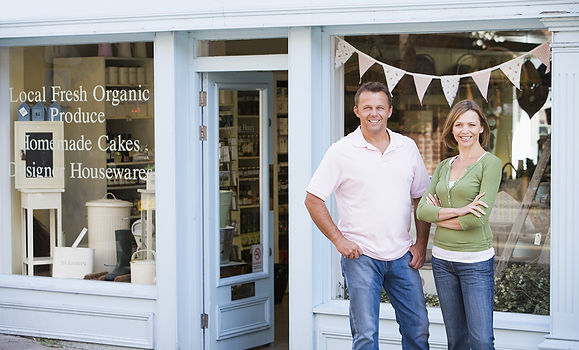 Small Business couple in front of store NSBA