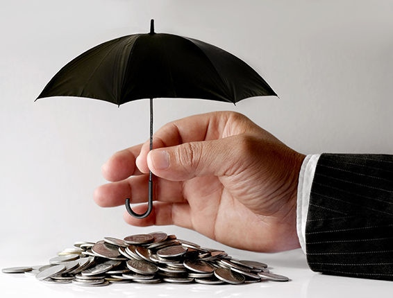 Hand holding umbrella over coins All Seasons Insurance