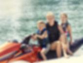 Family on jet ski All Seasons Insurance
