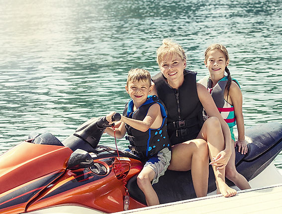 Family on jet ski All Seasons Insurance