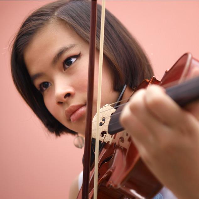 An Asian girl playing violin.jpg