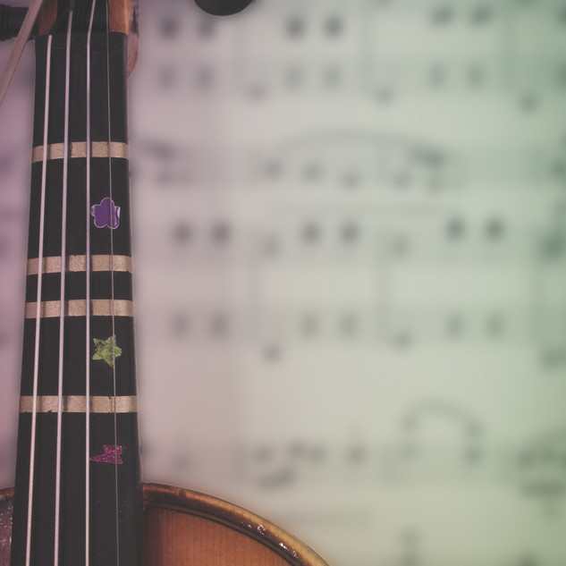Student Violin over blurred sheet music