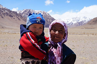 tipical kyrgyz woman with her child