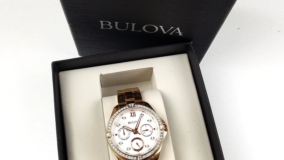 Bulova gold watch with diamond accents