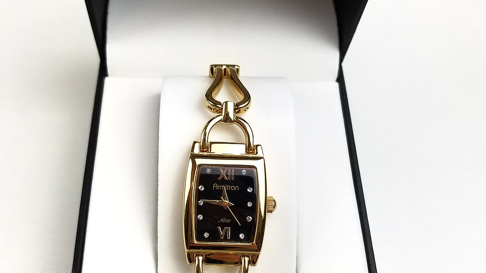Armitron watch gold with black face (new)