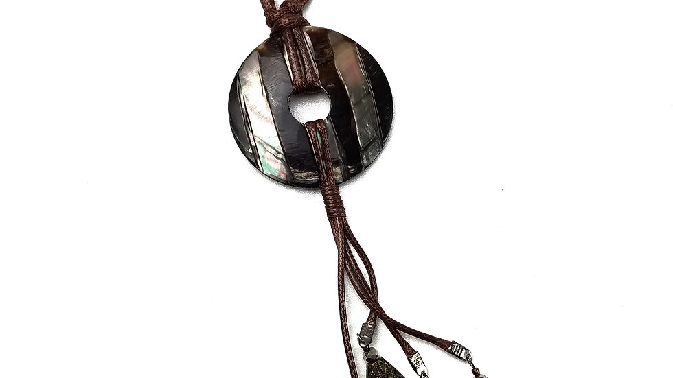 Necklace with brown circle pendant