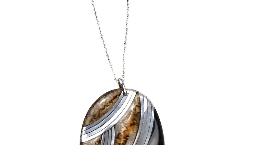 Long silver necklace with black/brown/silver oval pendant