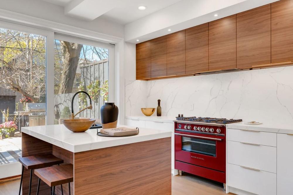 white kitchen, quartz, small kitchen island, solid backsplash