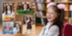 Веселая школьница читает букварь и делает уроки