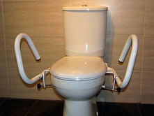 Throne 3-in-1 Toilet Support Rail in the Splayed position, powcercoated in white on a standard toilet