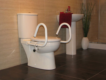 Throne 3-in-1 Toilet Support Rail in the standard position, powcercoated in white on a standard toilet