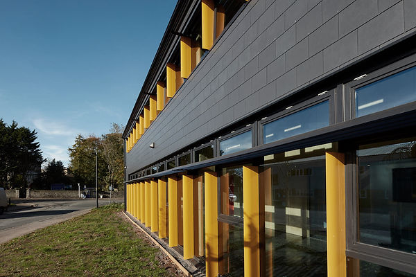 Cryer & Coe, Rawlings Bristol, exterior black cladding, PV panels, orang cladding, Warmley