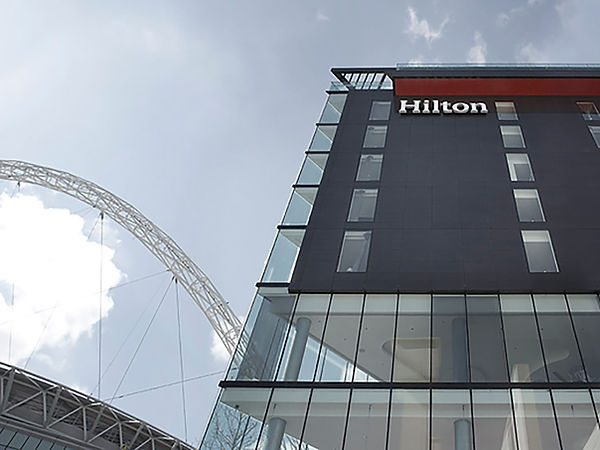 Hilton, Wembley Hilton, Wembley Stadium, Wembley Arena, Hotel, pool, suite, roof top bar, roof terrace, polished stone, flush windows, red tiles, glazed partions, ball room