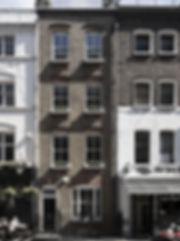 London, townhouse, atria, atrium, white interior, waterfall, large light feature, white kitchen