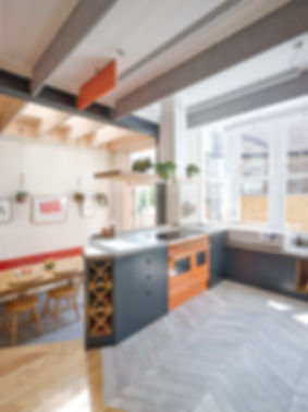 Kitchen renovation Bristol Orange kitchen extension refurbishment tiled floor acoustic baffles