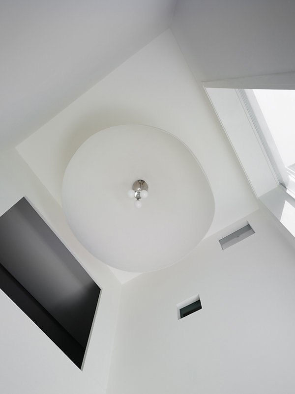 London, townhouse, atria, atrium, white interior, waterfall, large light feature, white kitchen