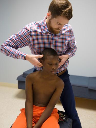 Brennon adjusting Ayden cervical.jpg