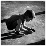 child playing in coloured dust.JPG