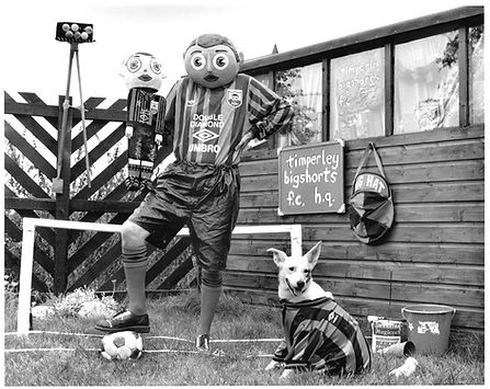 """Frank Sidebottom, Litte Frank and Wilma the dog at thir """"home ground"""" for Timperley Bigshorts"""