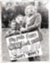 """'Sarah Gregory', Little Frank and Big Frank hold a sign saying """"My pals from Oink! don't smoke - Join 'em!"""""""