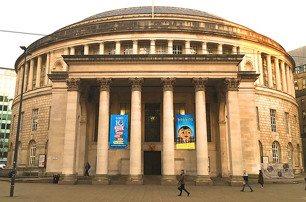 "Manchester Central Library displaying banners for ""Bobbins: The Fantastic Archive of Frank Sidebottom and Chris Sievey"""