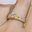 Thumbnail: 10kt Yellow Gold Bridge Ring .75ct TW