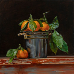 Tangerines in a bucket
